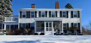 New England Inn on a clear blue day with snow