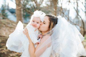 bride kissing a baby