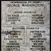 Grey stone marker with engraved lettering (Commander George Washington and other generals) marking Mount Independence Historic site.