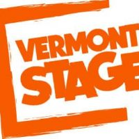 White sign with orange lettering with bracket to left of Vermont Stage.