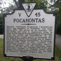 Information sign along road with text V45 Pocahontas explaining nickname of town Matoska