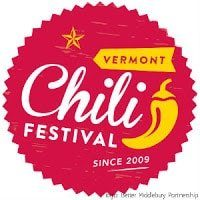 Red circular sign with white lettering (Chili Festival Since 2009) yellow Chili symbol and star.