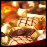 Box containing a variety of different chocolate candies.