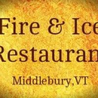 Yellow sign portraying a fireball, brown lettering Fire & Ice Restaurant