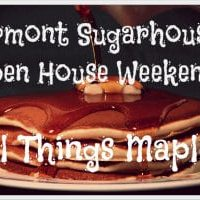 Stack of pancakes, butter pad and maple syrup sitting on plate Black sign with white lettering Vermont Sugarhouses Open House Weekend