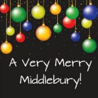 Hanging multi-colored Christmas bulbs on black sign with white lettering A Very Merry Middlebury!