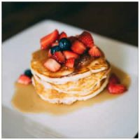 Pancakes with berries and syrup - photo by Herson Rodriguez www.unsplash.com