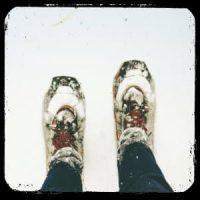 Snowshoes in snow - image by greg rakozy on www.unsplash.com
