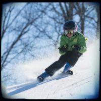 kid skiing - photo by Elissa Algora on www.unsplash.com
