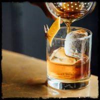 Cocktail glass - photo by Adam Jaime on www.unsplash.com