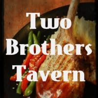 Barbeque chicken breast with steamed carrots and green beans on sign Two Brothers Tavern