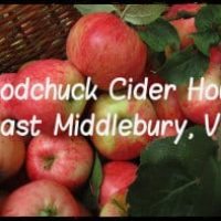 Brown basket of red apples and green leaves, Woodchuck Cider House Sign