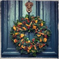 Wreath hanging on a door - photo by Jez Timms on www.unsplash.com