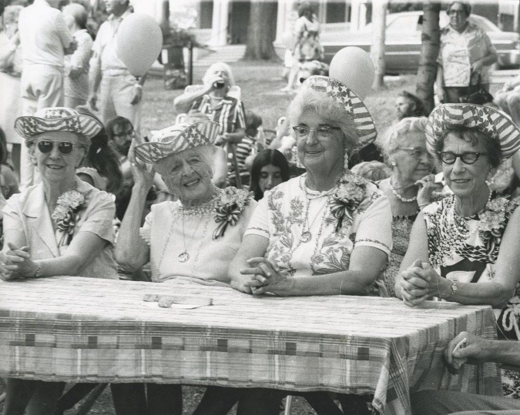 four senior ladies sitting at a table